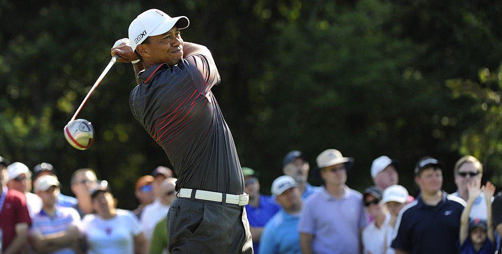 Tiger Woods fired a seven-under 64 to finish two shots off the lead at the Deutsche Bank Championship.
