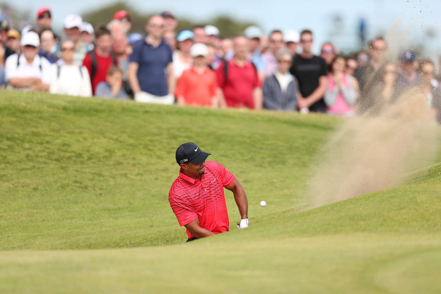 Woods triple bogeyed No. 6 after he struggled to get out of a bunker.