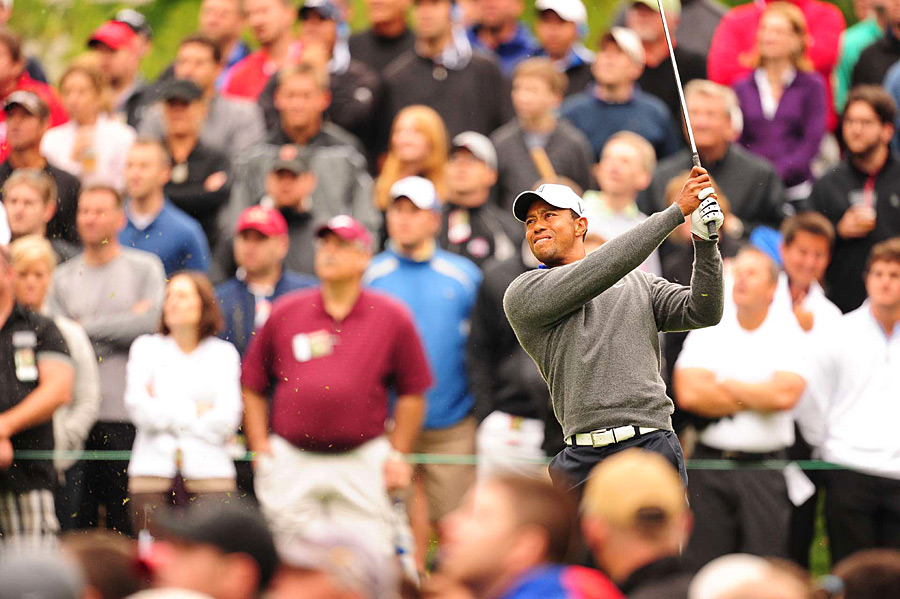 Tiger Woods shot a three-under 69 to finish one shot off the lead.