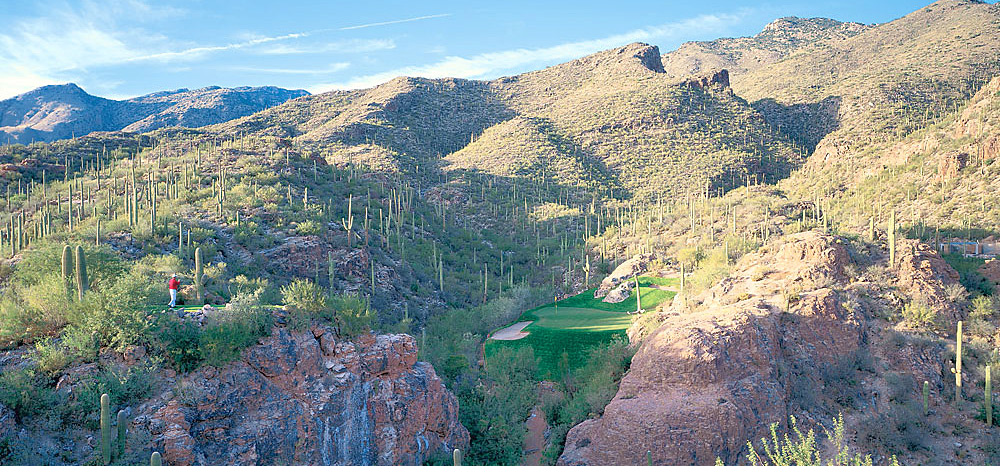 "8. Ventana Canyon (Mountain) -- No. 3: Par 3, 107 yards -- Tucson, Ariz.                           For pure fantasy calendar aspects alone, you've got to play at least one hole carved from what once would have been thought of as the most inhospitable, unlikely golf canvas of all: the desert southwest. In 1984, when architect Tom Fazio sculpted ""Hole in the Wall,"" he called it ""the most expensive hole I've ever built."" Today, it might be his most photographed. The requirements are simple: punch a three-quarter wedge over a chasm to a two-tier shelf of green surrounded by a mountain full of Saguaro cacti. Easier said than done."