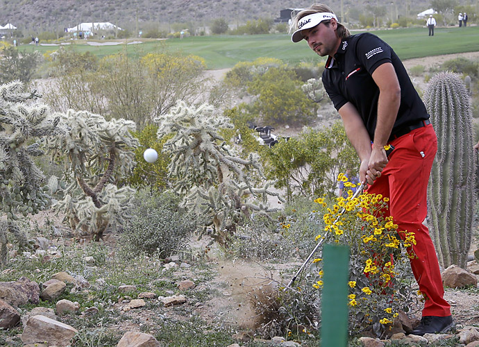 Dubuisson's shotmaking out of the desert on No. 19 and (pictured) No. 20 -- where he chipped out from underneath a branch to within a few feet of the hole -- extended the match and left viewers in varying degrees of shock.