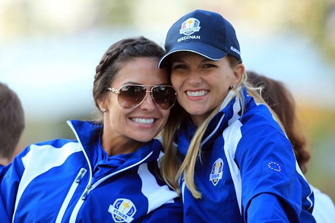 Kristin Stape, now Kristin McDowell, and Kate Rose pose together decked out in Team Europe attire at the 2012 Ryder Cup.