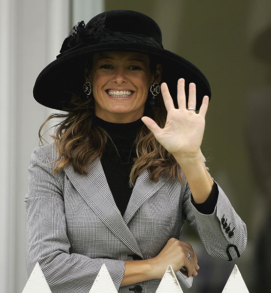 Tabitha Furyk waves for the cameras at the 2010 Ryder Cup.