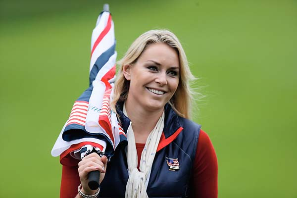 Lindsey Vonn follows the play of Tiger Woods on Sunday during the weather-delayed Day Three foursome matches.