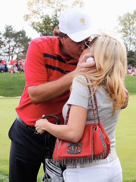 Phil Mickelson kisses his wife Amy on the 17th hole after the team of Mickelson/Bradley defeated the Els/de Jonge team 2 & 1 during the Day Three four-ball matches.