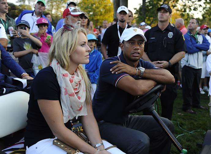 Tiger Woods and Lindsey Vonn with members of the U.S. Team follow the play during the Day One four-ball matches.