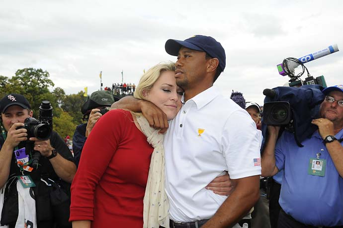 Tiger Woods is congratulated by Lindsey Vonn after Woods 1-up victory over Richard Sterne in Sunday singles.
