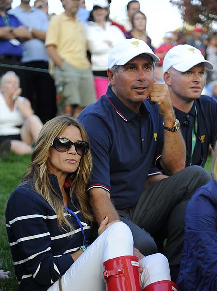 U.S. Team captain Fred Couples and girlfriend Nadine Moze follow the play during the Day Onefourball matches.