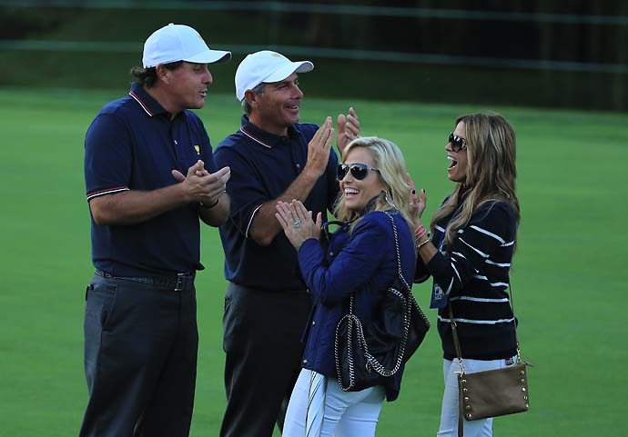 Phil Mickelson and Fred Couples  wait with Amy Mickelson and Nadine Moze during the Day One fourball matches.