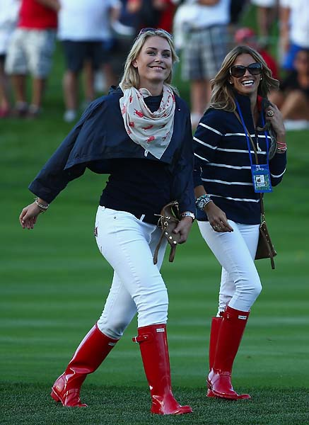 Lindsey Vonn and Fred Couples' girlfriend Nadine Moze walk up a fairway during the Day One fourball Matches at the Muirfield Village Golf Club.