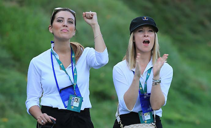 Ellie Day [left] and Ruby DeLaet watch the play of the International Team during the Day One fourball Matches at the Muirfield Village Golf Club.