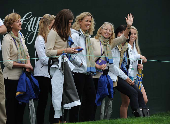 International Team wives and girlfriends follow the play during the Day Three fourball matches.