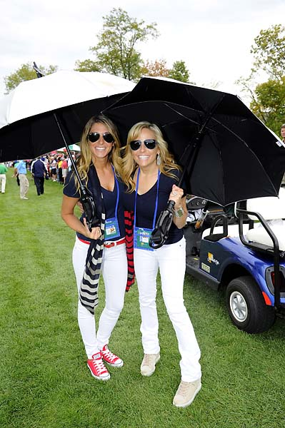 Jillian Stacey [Keegan Bradley's girlfriend] and Amy Mickelson follow the play of the U.S. Team during the Day One fourball matches.
