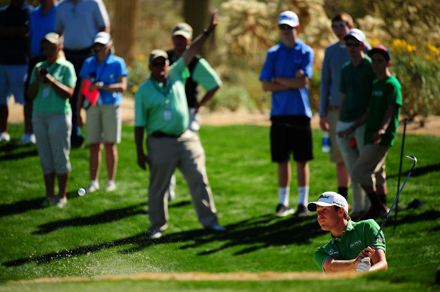 Watney defeated Tiger Woods on Thursday, but he couldn't get by Westwood on Friday.