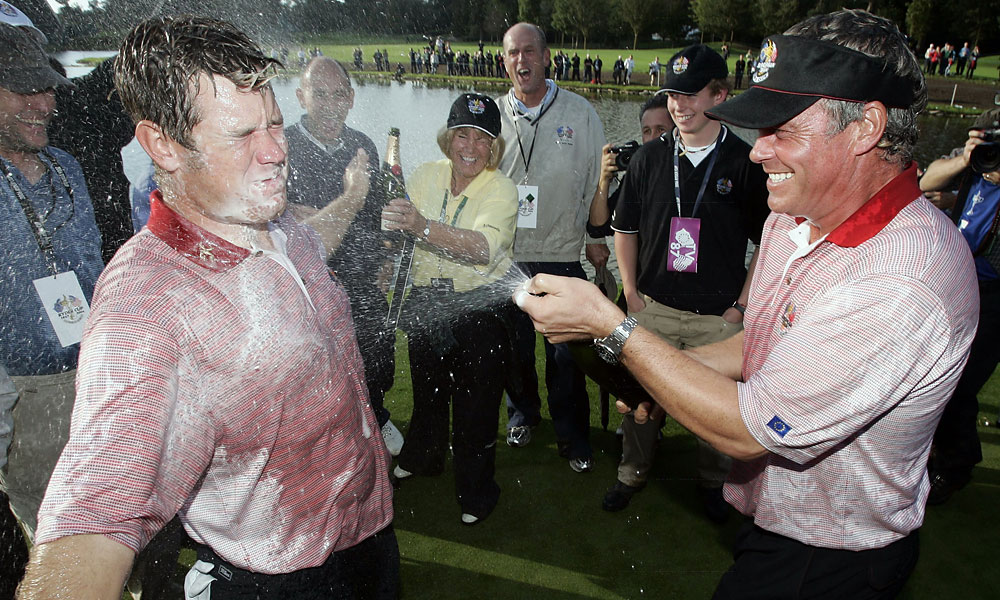 Darren Clarke sprayed Lee Westwood after Europe won its third consecutive Ryder Cup 18 1/2 - 9 1/2.