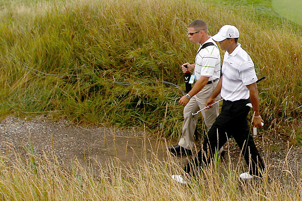Foley videotaped Woods's swing on the course Tuesday leading to speculation that the two were working together.