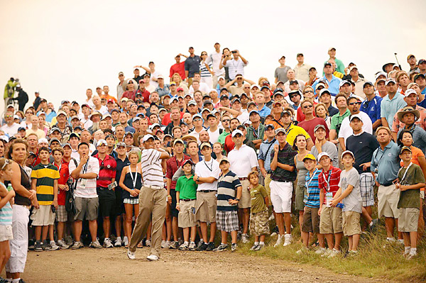 Woods found trouble on the par-5 second hole, hitting his second shot onto a dirt path in the gallery. He then hit a fairway wood while surrounded by fans and eventually saved par.