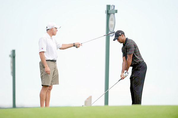 Woods, who broke ties with his swing coach Hank Haney earlier this season, worked with his caddie, Steve Williams.