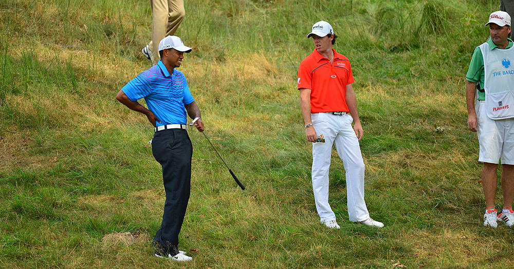 Despite a back injury Friday, Tiger Woods shot a two-under 69 to finish three shots off the lead.