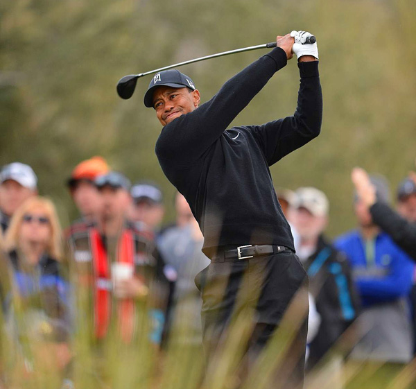 """We both played well,"" Woods said. ""He made a couple of more birdies than I did. He played well, and he's advancing."""