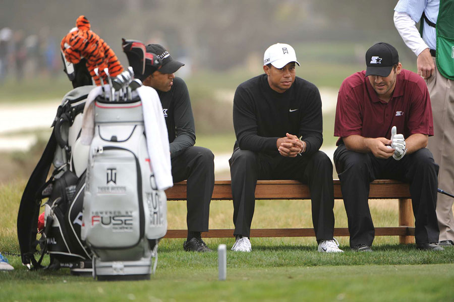 For the second day in a row, Woods was joined by Dallas Cowboys QB Tony Romo.