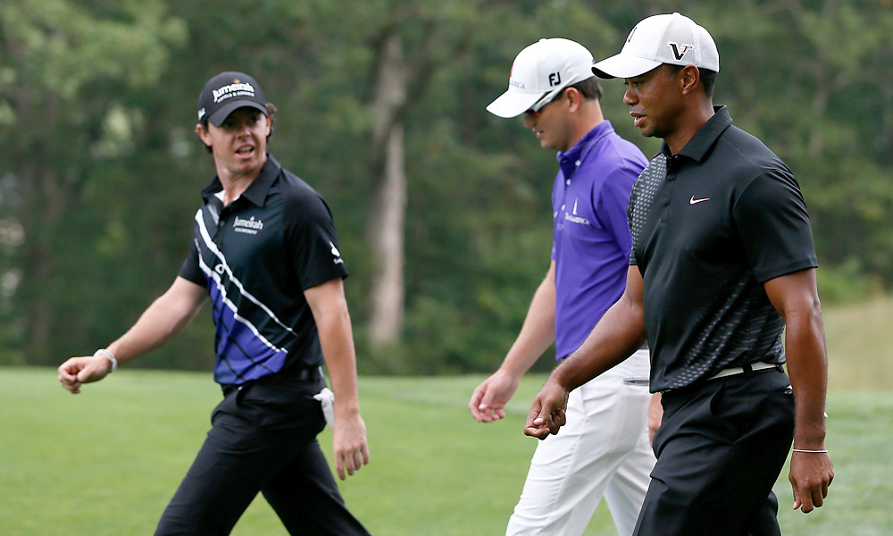 Zach Johnson (center) was also paired with Woods and McIlroy on Thursday.