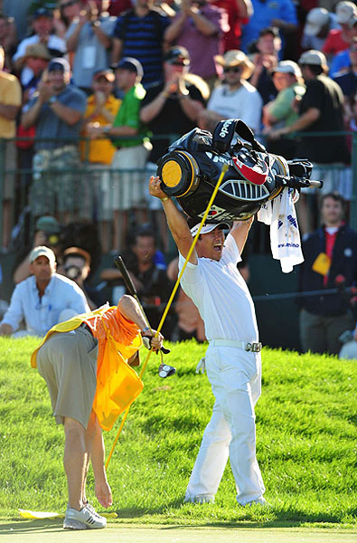 SI's photographers captured all the exciting moments at Hazeltine. Here are their best photos.                       A first? Champion Y.E. Yang lifted his entire golf bag in celebration of his first major win.
