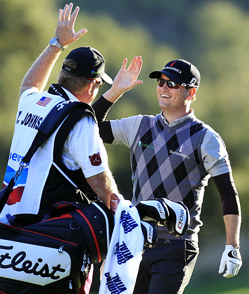 Zach Johnson eagled the par-4 18th to shoot a four-under 68 and take a one-shot lead into the final round.