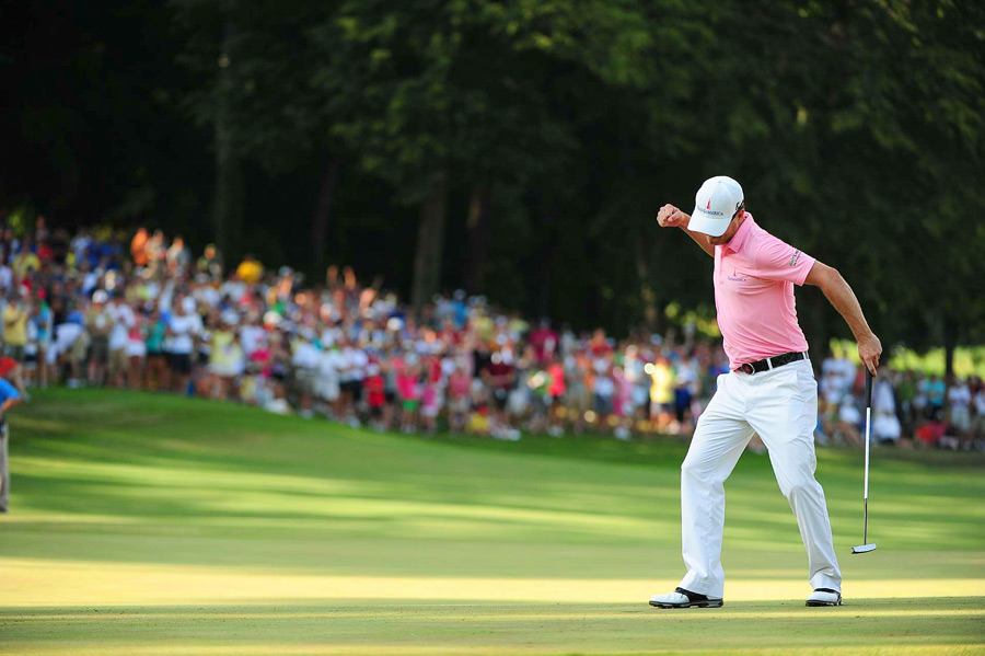 Zach Johnson birdied the second playoff hole to defeat Troy Matteson and win the John Deere Classic.