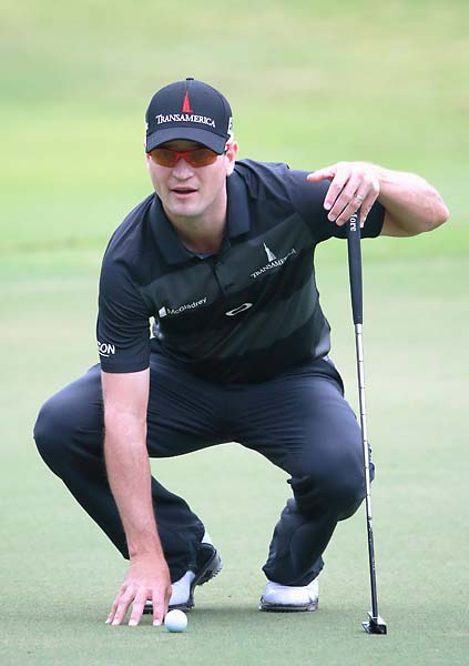 Zach Johnson lines up a putt on the 17th green during the third round of the Tour Championship on Saturday.