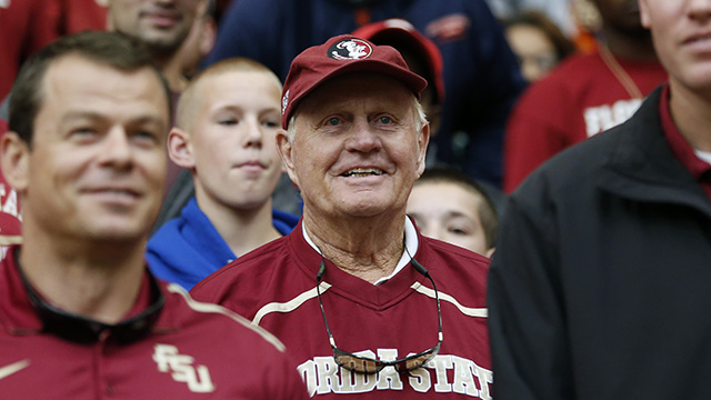 Golfer Jack Nicklaus watches as Florida State players leave the field after their 38-20 win over Syracuse on Oct. 11, 2014.