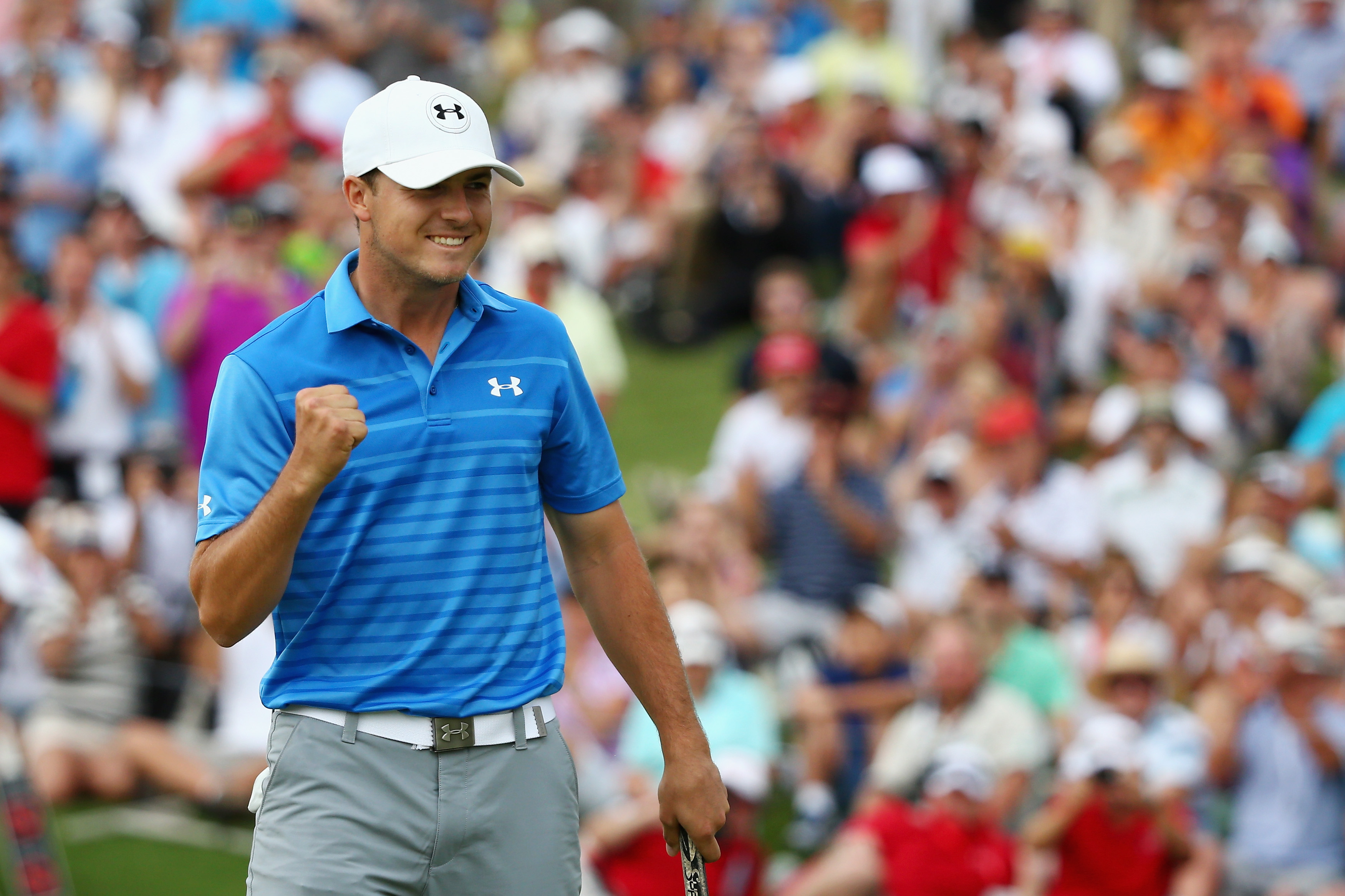 Jordan Spieth celebrates on the 18th green following his Australian Open victory.