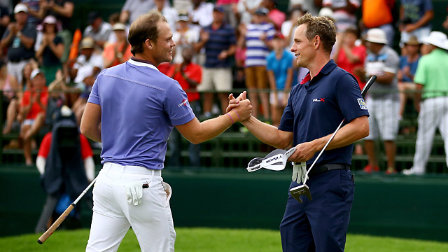 Luke Donald congratulates Danny Willett after Willett secures victory during the final round of the Nedbank Golf Challenge.