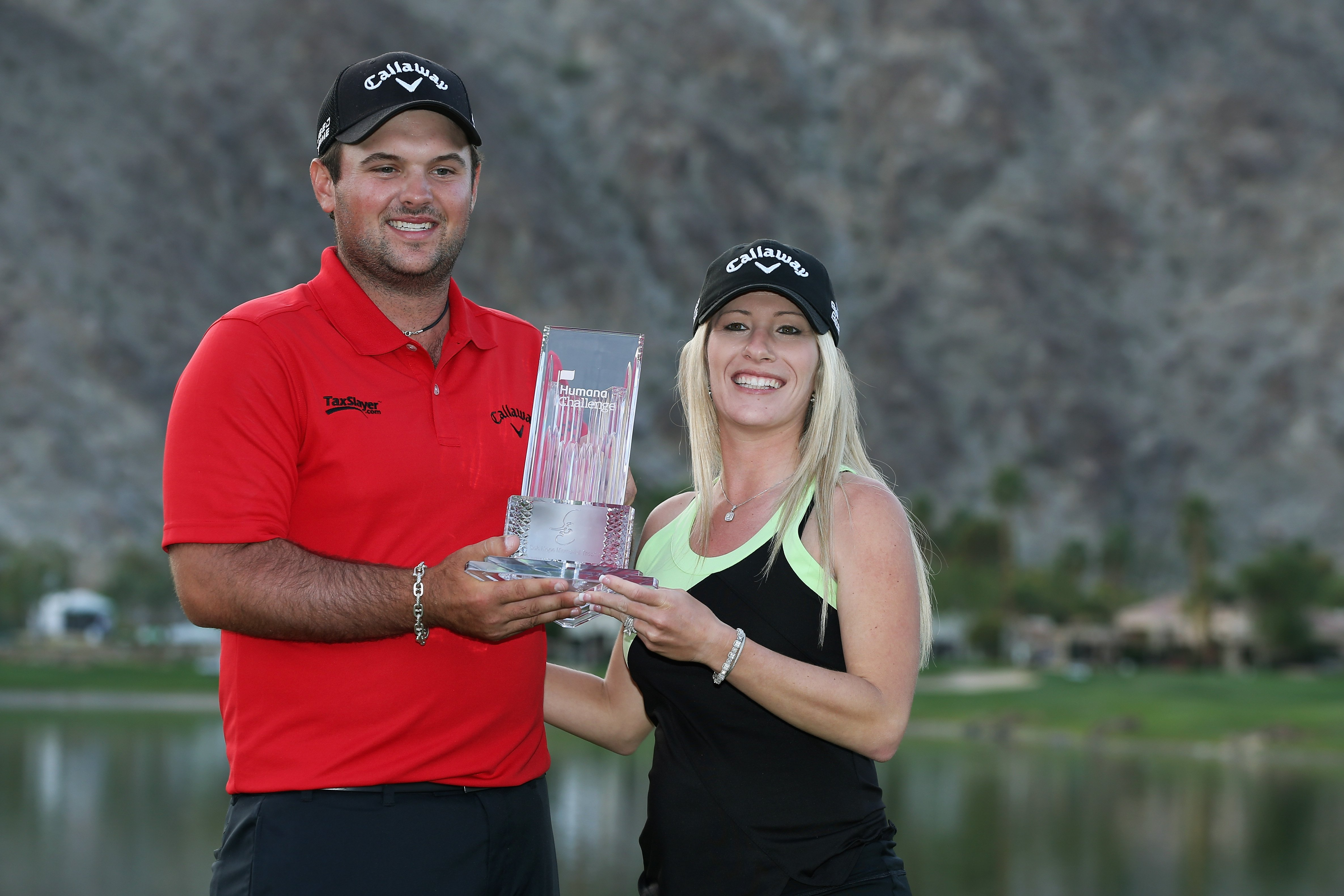 Patrick and Justine Reed pose with his trophy after winning the 2014 Humana Challenge.
