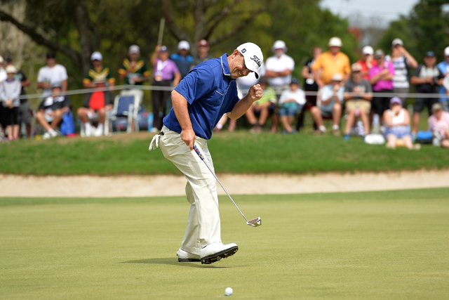 Greg Chalmers of Australia celebrates as he sinks his putt to take the lead on the final hole during day four of the 2014 Australian PGA Championship at Royal Pines Resort in Gold Coast, Australia.