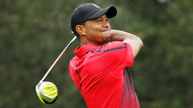 Tiger Woods hits his tee shot on the fourth hole during the final round of the Hero World Challenge at the Isleworth.