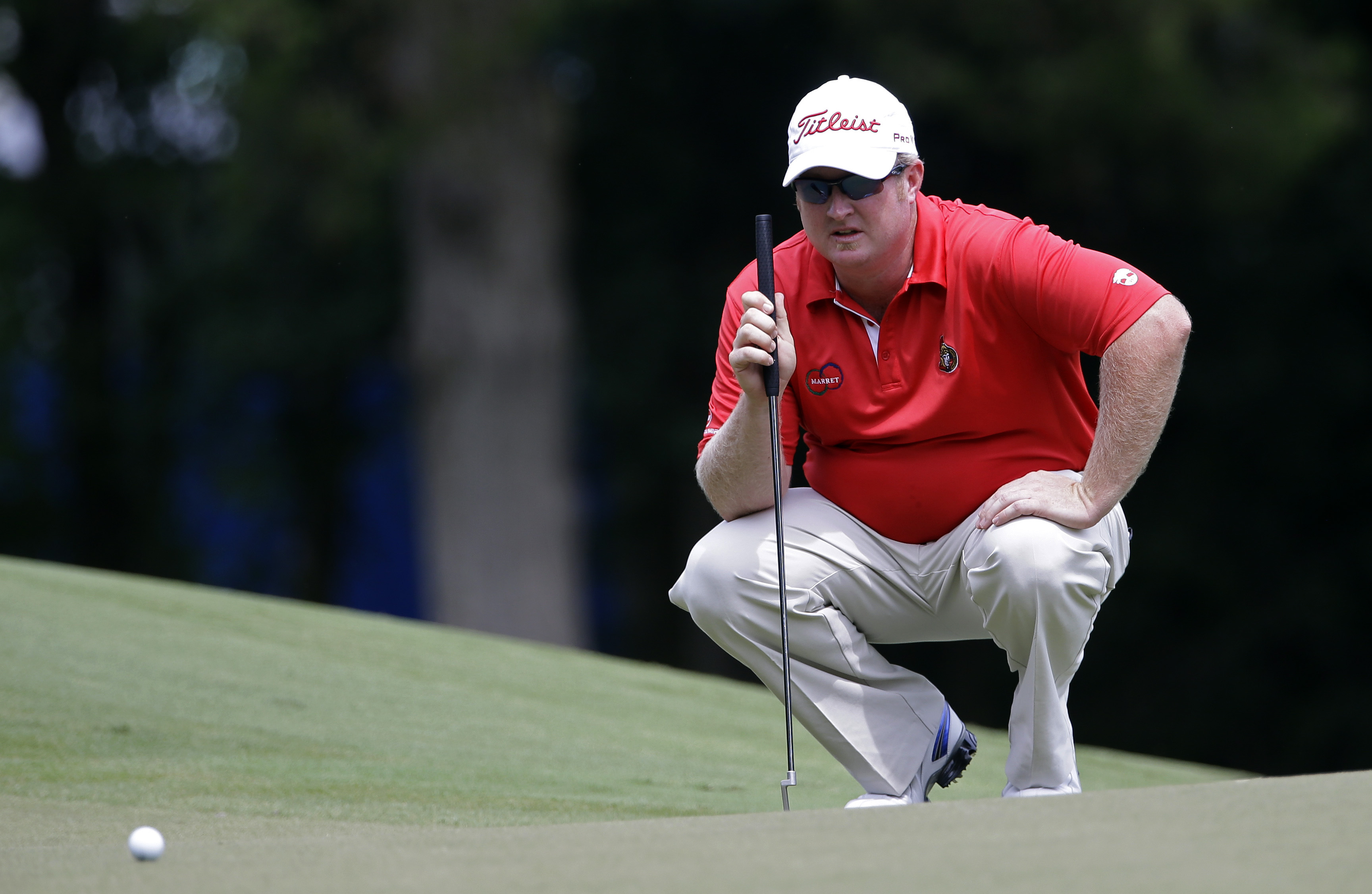 Brad Fritsch lines up a putt on the first green during the final round of the 2014 Wyndham Championship.
