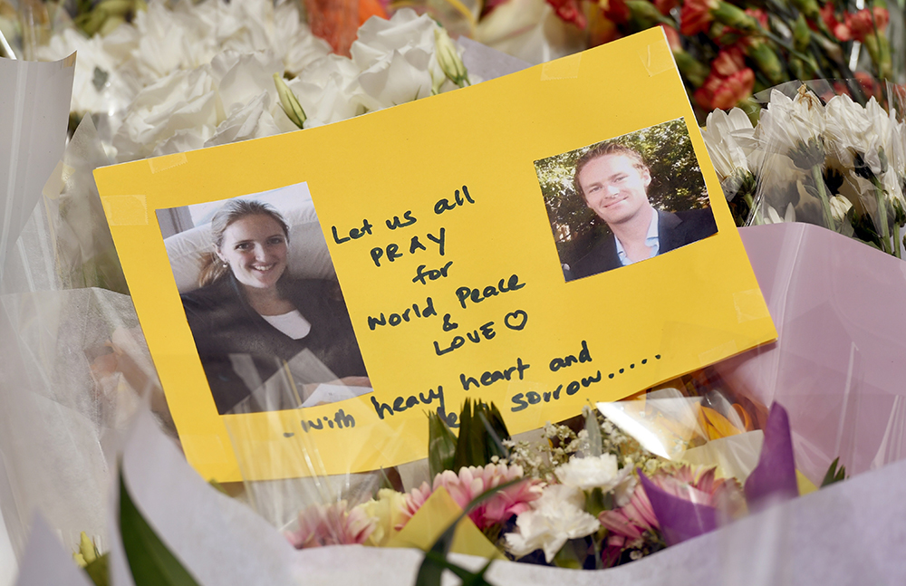 A memorial card shows photos of Katrina Dawson, left, and Tori Johnson, the two hostages killed during a fatal siege in the heart of Sydney's financial district.