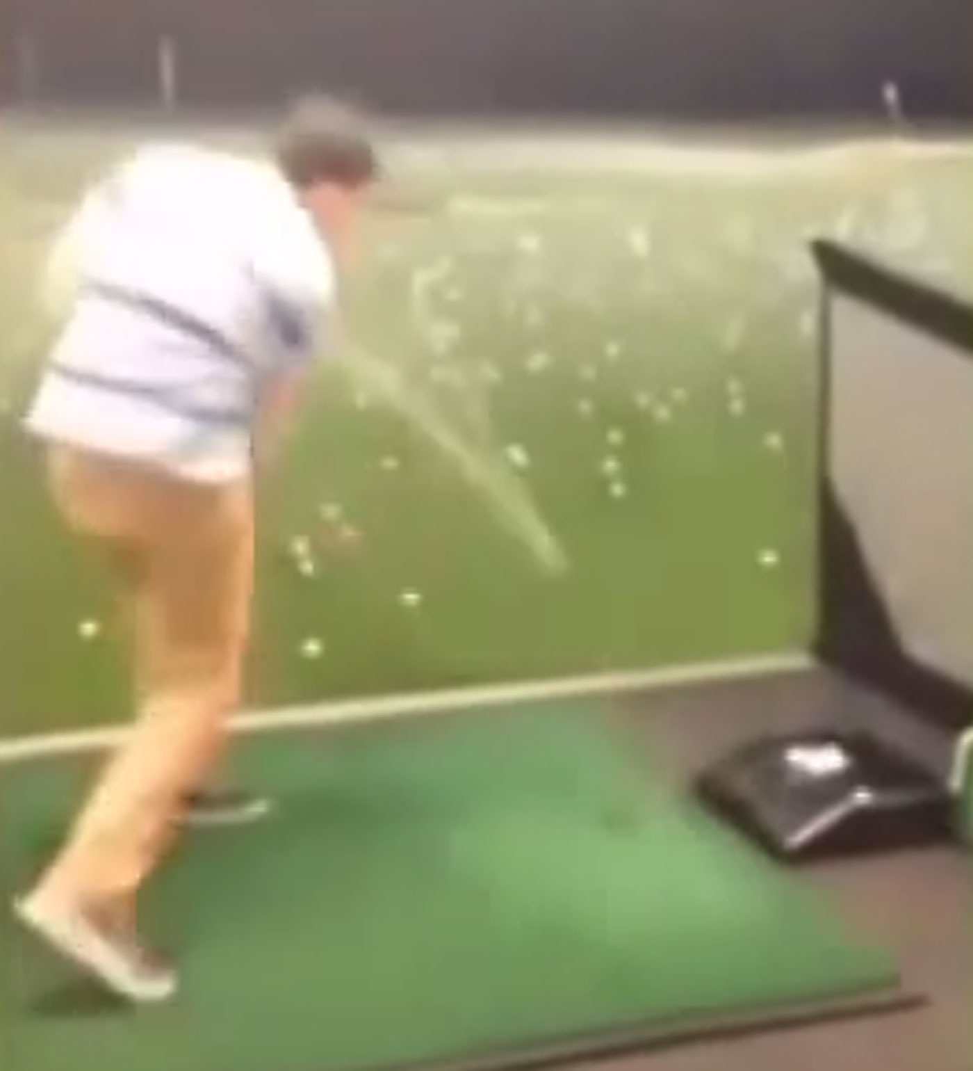 Guy hits self in face with ball at driving range