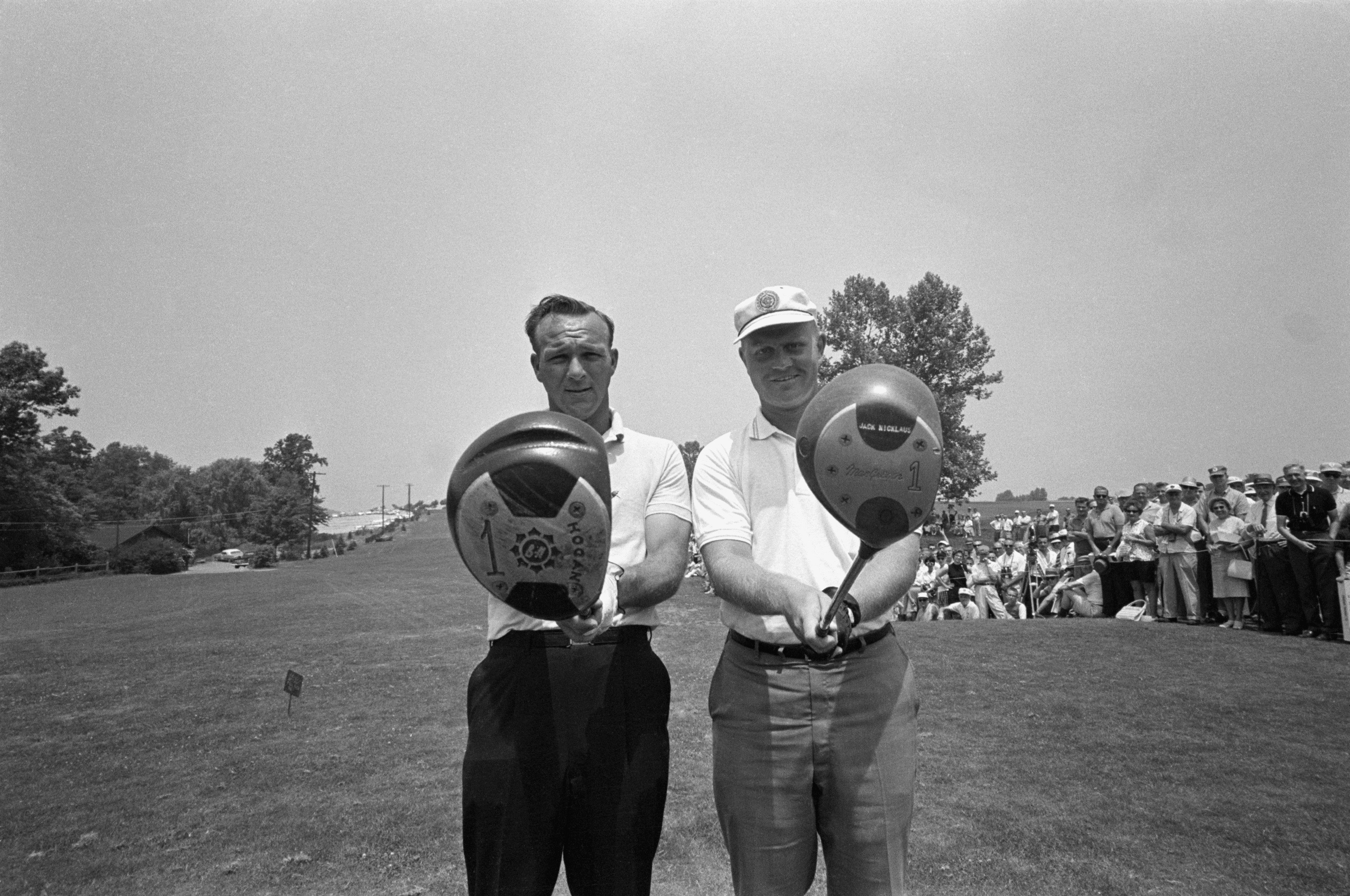 Arnold Palmer and Jack Nicklaus check their drivers before teeing off for a tie breaking playoff in the 1962 US Open.