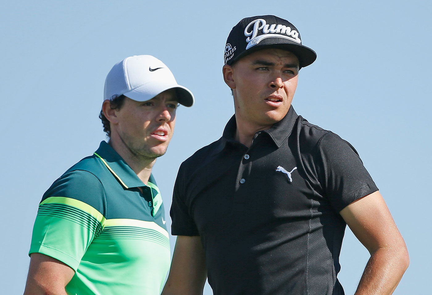 Rory McIlroy and Rickie Fowler both shot 67 Thursday in Abu Dhabi.