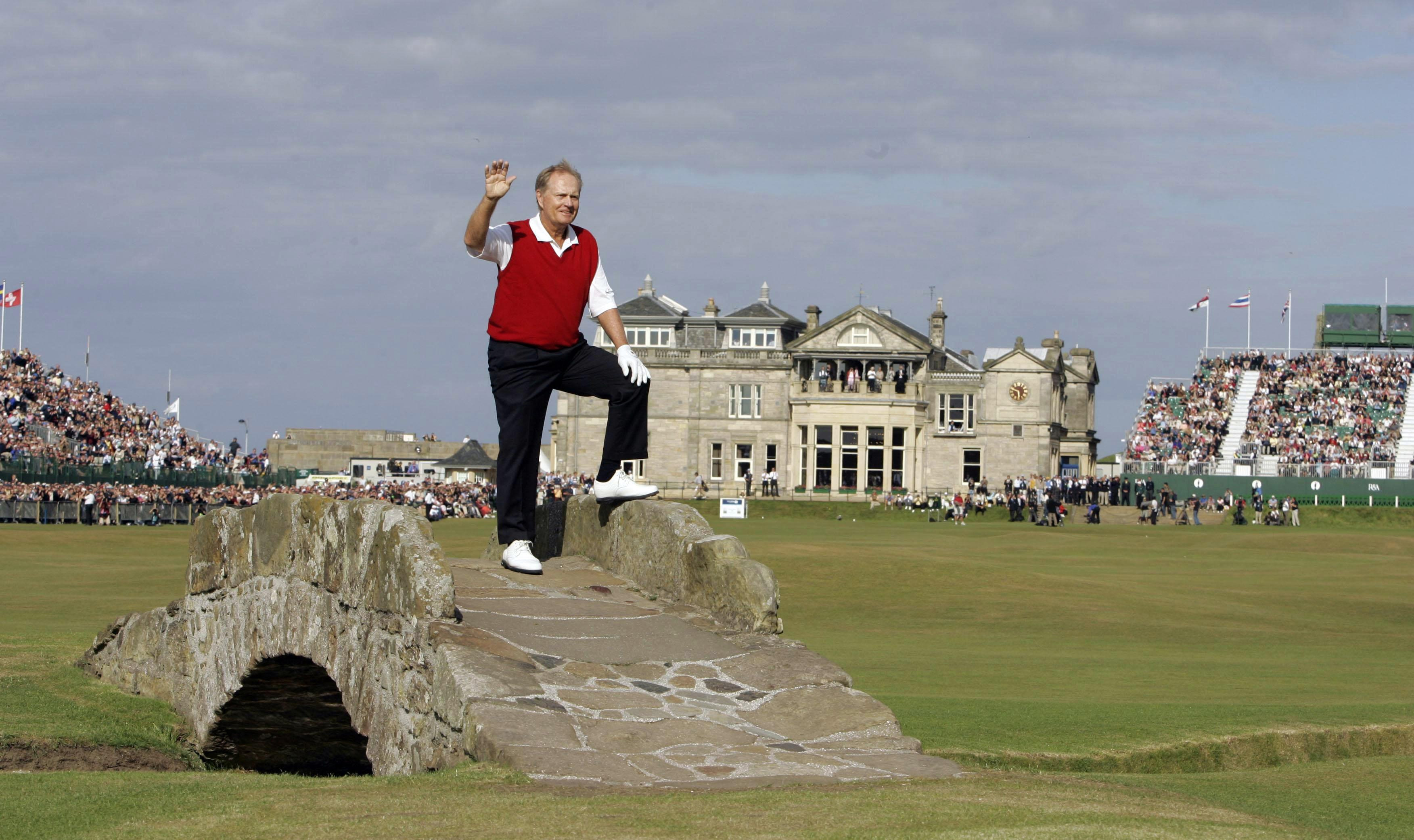 Jack Nicklaus waves to the crowds on the eighteenth hole during his final round at the British Open in 2005 at St. Andrews.