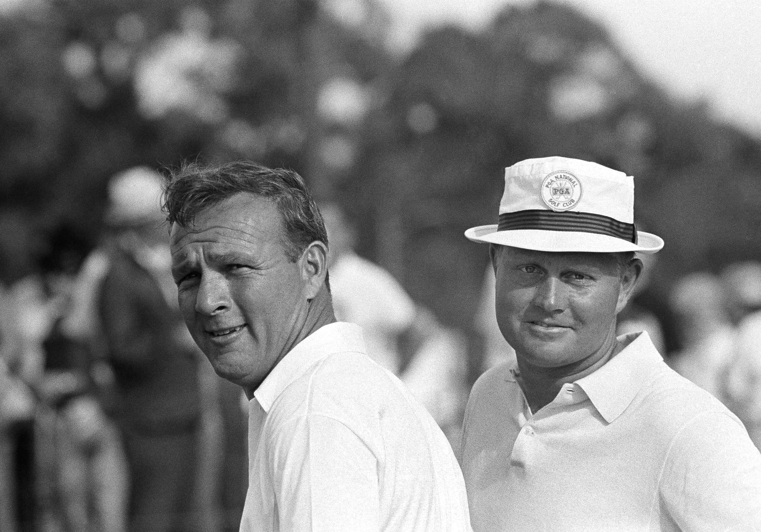 Arnold Palmer, left, and his partner Jack Nicklaus, are two happy golfers after wining the $250,000 PGA National Team Championship with a low score of 256 for 72 holes, Dec. 10, 1966, West Palm Beach, Fla.