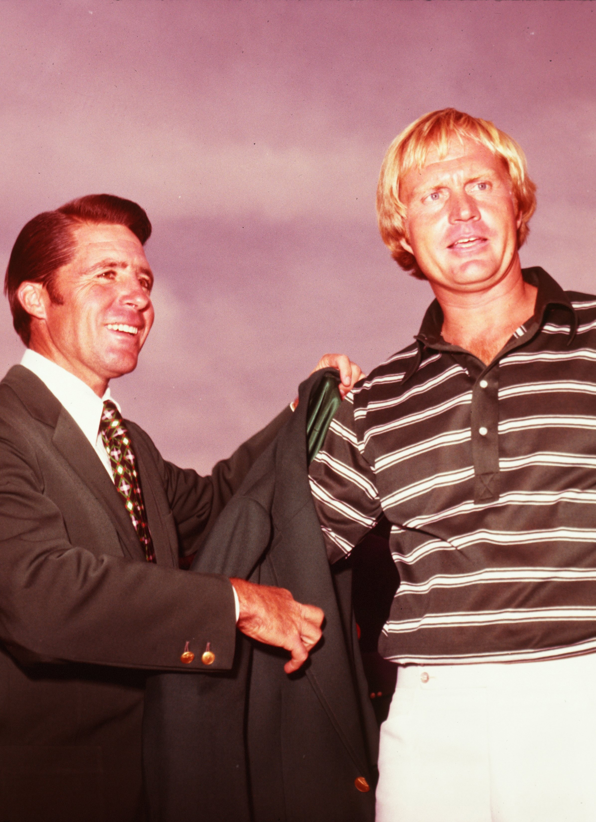 1974 Masters Champion Gary Player presents 1975 Masters Champion Jack Nicklaus with his green jacket.