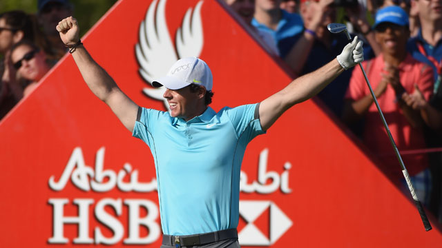 Rory McIlroy celebrates his first professional hole-in-one at the Abu Dhabi Championship on Friday.