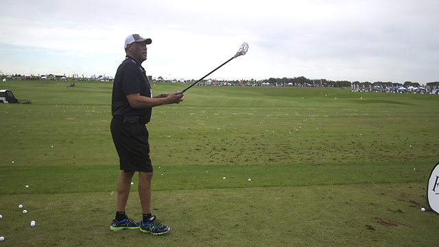 "Former Boston Celtic M.L. Carr demonstrates ""FlingGolf"" at Demo Day."