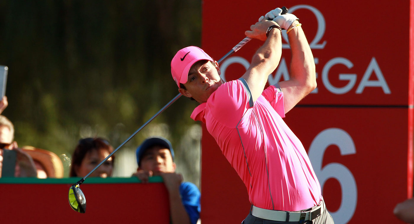 Rory McIlroy leads in Dubai by a shot after a second-round 64.