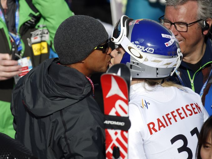 Vonn kisses Woods after run one of the giant slalom at the world championships Feb. 12 in Beaver Creek, Colo.