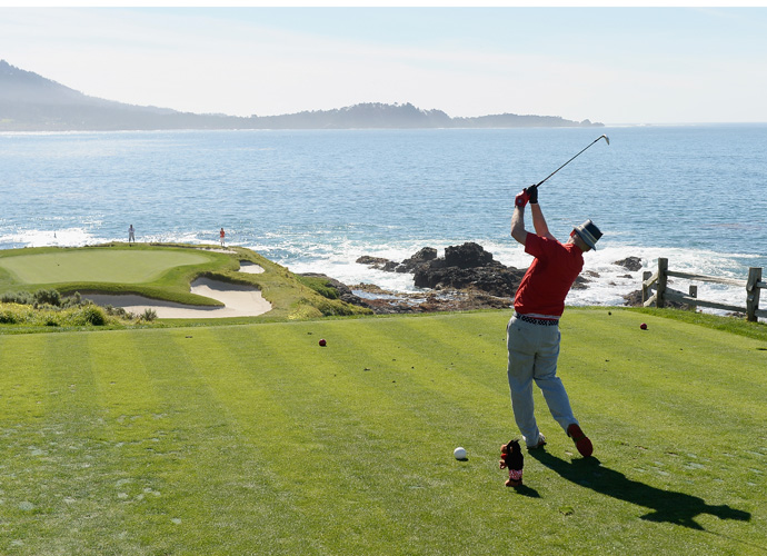 Actor Bill Murray watches his tee shot on the seventh hole during the third round of the AT&T Pebble Beach National Pro-Am at the Pebble Beach Golf Links on February 14, 2015 in Pebble Beach, California.