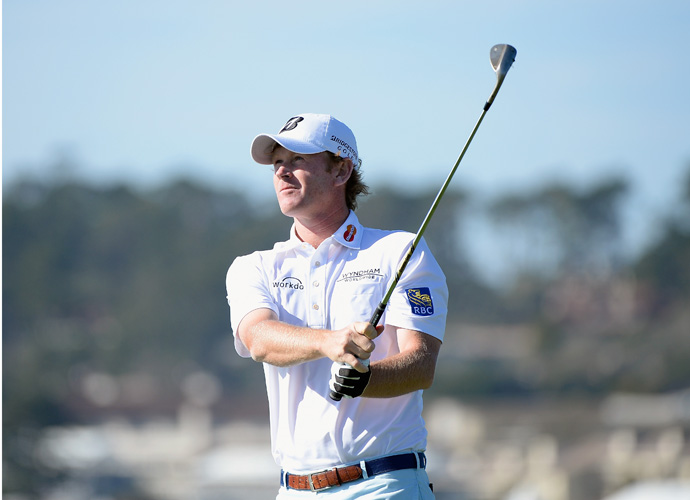 Brandt Snedeker watches his tee shot on the seventh hole during the third round of the AT&T Pebble Beach National Pro-Am. Snedeker, yesterday's leader, fell two spots to sit at -16 (with Nick Watney) after three rounds.